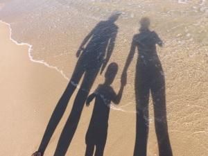 ombre genitori col bambino